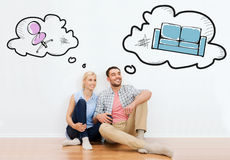 Happy couple of man and woman moving to new home Stock Photos