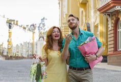 Happy couple man and woman with shopping bags Stock Image