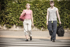 Happy couple man and woman with sport bags. Royalty Free Stock Photo