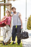 Happy couple man and woman with sport bags. Royalty Free Stock Images