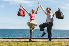 Happy couple man and woman with sport bags. Stock Photo