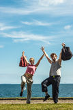 Happy couple man and woman with sport bags. Stock Image