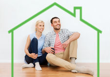 Happy couple of man and woman to new home Stock Photography