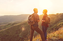 Happy couple man and woman tourist at top of mountain at sunset. Happy couple men and women tourist at top of mountain at sunset outdoors during a hike in summer Stock Photography