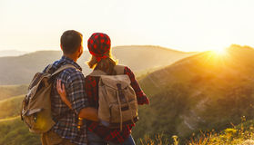 Happy couple man and woman tourist at top of mountain at sunset. Happy couple men and women tourist at top of mountain at sunset outdoors during a hike in summer Royalty Free Stock Photos