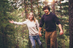 Happy Couple Man and Woman Travelers running Royalty Free Stock Photo