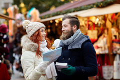 Happy couple with map and city guide in old town Royalty Free Stock Photography
