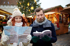 Happy couple with map and city guide in old town Stock Images