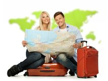 Happy couple with map Stock Photography
