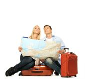 Happy couple with map Stock Images