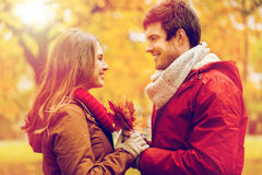 Happy couple with maple leaves in autumn park Royalty Free Stock Images