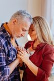 Couple of mature people feeling really happy with each other. Really happy. Couple of mature good-looking people feeling really good and happy with each other royalty free stock photos