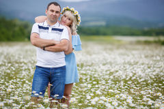 Happy couple on a meadow among the flowers Royalty Free Stock Photos