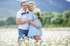 Happy couple on a meadow among the flowers Stock Image