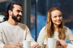 Happy couple meeting and drinking tea or coffee Royalty Free Stock Images