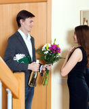 Happy couple meeting together at home door Stock Images