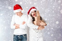 Happy couple man and fat woman celebrate Christmas and new year. Happy couple men and fat women celebrate Christmas and new year. Man and women model plus size Royalty Free Stock Image