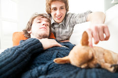 Happy couple of men with a little Chihuahua