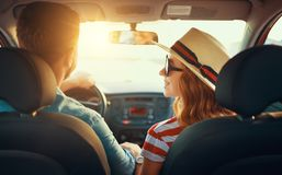 Happy couple man and woman in car traveling in summer royalty free stock photos
