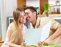Happy couple with menu Royalty Free Stock Images