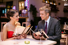 Happy couple with menu card Royalty Free Stock Photos