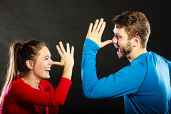 Happy couple mocking having fun playing the fool. Joyful men and women have nice time. Good relationship stock photos