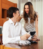 Happy couple with money in home interior Royalty Free Stock Photo