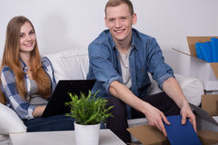 Happy couple during move. Image of happy pair during move to new dwelling place Stock Image