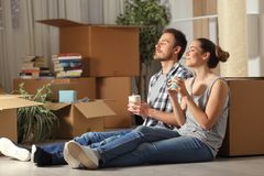 Happy couple moving home resting breathing fresh air stock photography