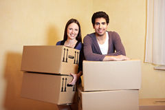 Happy couple moving house Stock Images