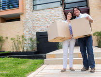 Happy couple moving house Stock Photos