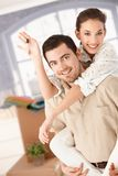 Happy couple moving house smiling stock photography