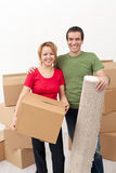Happy couple moving into a new home Stock Image