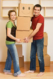 Happy couple moving into a new home royalty free stock photo