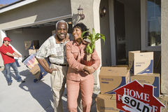 Happy Couple Moving Into New House Royalty Free Stock Images