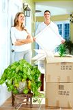Happy couple moving in a new house. Stock Photos