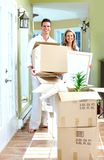 Happy couple moving in a new house. Royalty Free Stock Photos