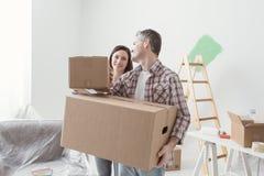 Couple moving into a new house stock photos
