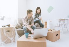 Couple moving into their new house stock photo
