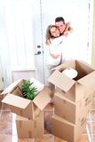 Happy couple moving in a new house. Stock Photo
