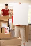 Happy couple moving into new place Royalty Free Stock Images
