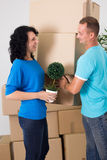 Happy couple moving to new house Stock Images