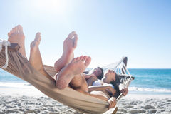 Happy couple napping together in the hammock Royalty Free Stock Photo