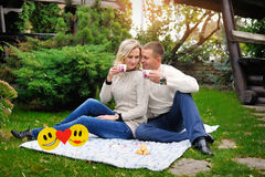 Happy couple in nature drinking tea outdoors Stock Image