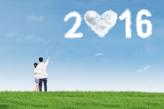 Happy couple in nature with numbers 2016 Royalty Free Stock Images