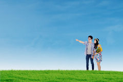 Happy couple in nature under blue sky Stock Photography
