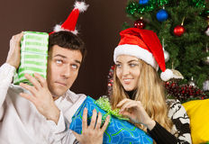 Happy couple near the Christmas tree Stock Photos