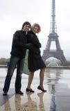 Happy couple near the Eiffel tower Royalty Free Stock Photos