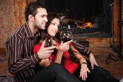 Happy couple near fireplace Royalty Free Stock Images