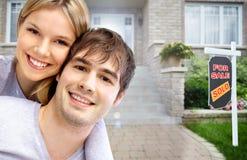Happy couple near new house. Stock Photography